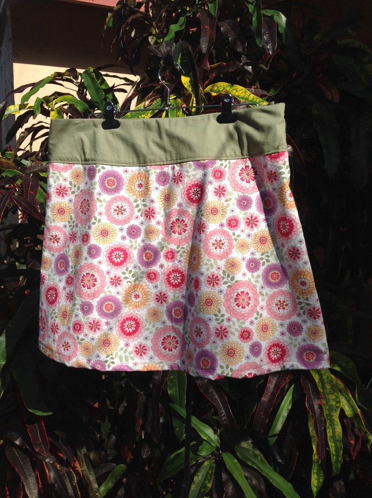 This fun pink floral pattern was a bit too see-through, so it is lined in the same green cotton seen in the yoke waistband.